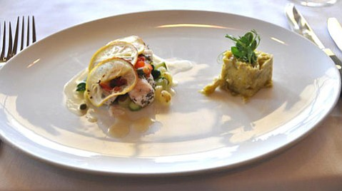 "Americana Festival-goers might enjoy Tognazzini ""Dockside Too's"" Local Catch with capers, roasted red peppers, Meyer lemon, pan-roasted peewee potatoes, and shallot butter sauce alongside a leek compote, as prepared by Chef Gregg Wangard of The Cliffs Resort."