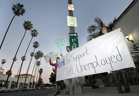 Former employees gather outside the now-closed Melting Pot at 608 Anacapa Street to protest the restaurant's closing
