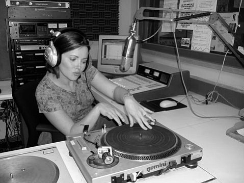 DJ Darla Bea practices her turntablism in the KJUC studio.