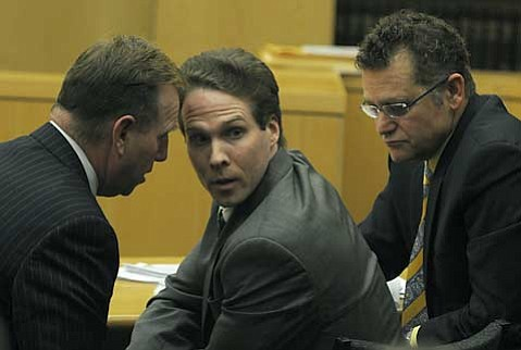 Jesse James Hollywood (center) flanked by defense attorneys James Blatt (left) and Alex Kessel.