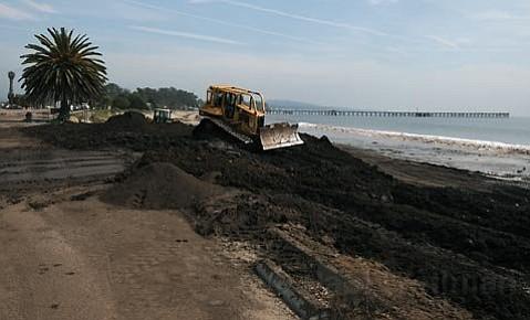 Dozers work on sand relocation at Goleta Beach Feb. 18, 2010