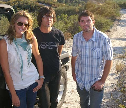 <strong>SIPPING SIBLINGS:</strong>  After four-wheeling to their favorite overlook, the Conway siblings, Gillian (left, in charge of marketing), John (middle, globe-trotting rock star with The Bravery), and Tom (right, in charge of sales) relax while overlooking their family's Rancho Arroyo Grande.