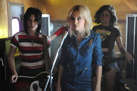 Joan (Kristen Stewart), Cherie (Dakota Fanning), and Robin (Alia Shawkat) of <em>The Runaways</em>.