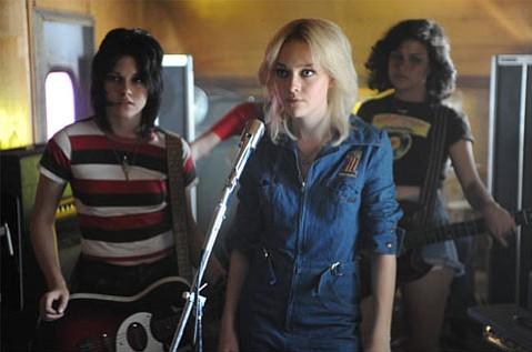 Joan (Kristen Stewart), Cherie (Dakota Fanning), and Robin (Alia Shawkat) of <em>The Runaways</em>.