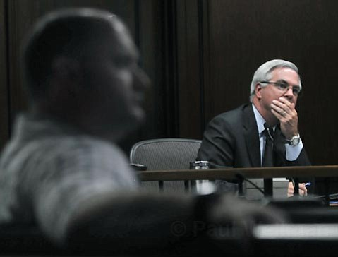 <strong>MO' MONEY:</strong>  City Administrator Jim Armstrong (right) is seeking $2.6 million in wage concessions from city employee unions. But the cops' union (represented by officer Jaycee Hunter, in foreground) contends he's squeezing too hard.