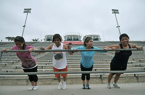 L to R Liz Gomez, Andrea Rosales, Denisse Elizarraraz, and Veronica Duran of Santa Ynez Valley High School work out at La Playa Stadium