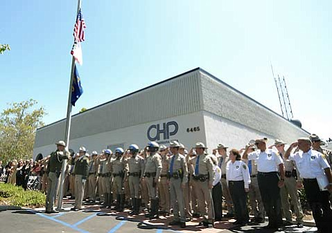 CHP officers salute flags at half mast during a memorial ceremony for fallen officer Jarrod Martinez May 3, 2010