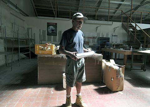 <strong>MOVING DAY:</strong>  After more than 25 years of working in the shop space at 120 Gray Avenue, Mark Heinz (pictured) has to relocate his commercial refrigeration and air conditioning metal shop after receiving a 30-day eviction notice late last month. Heinz is one of 14 tenants in the longtime work yard who are being kicked out by their landlord after the city tagged the space with numerous zoning, building, and fire code violations.