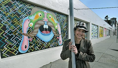 Mural project revitalizes vacant building front, provides an opportunity for artists to showcase their work.