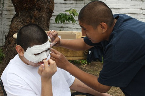 Students in the City at Peace project worked with masks to discover the roles at the heart of their stories.
