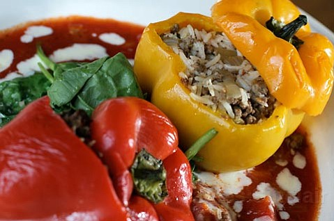 "<strong>ARGENTINE EATS:</strong>  Try the ""pimientos rellenos,"" red and yellow bell peppers stuffed with coconut rice and ground beef."