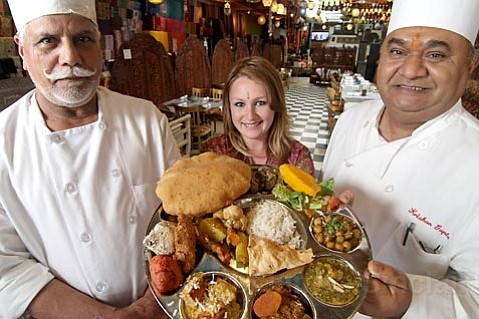 <strong>GHEE-T UP:</strong>  Indian food gets special treatment at India House, where, from left, head chef Sohan Singh, server Sara Coyne, and owner Krishan Gupta are proud to be spicing up State Street.