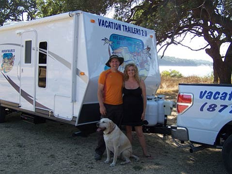 "<strong>VACATIONS ON WHEELS:</strong>  For the past year, Jason and Rendy Kimbrell, pictured above with their dog, Billie, have been delivering their luxury rental trailers to campgrounds throughout the county. ""We looked everywhere from San Diego to Northern California,"" explained Jason. ""We picked Santa Barbara because I went to college there, because it's a fabulous place with fabulous campgrounds, and we were able to contract with the state parks."""
