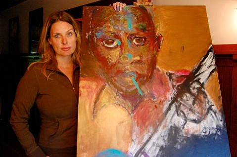 Kimberly McBride and one of her paintings of Robert Johnson