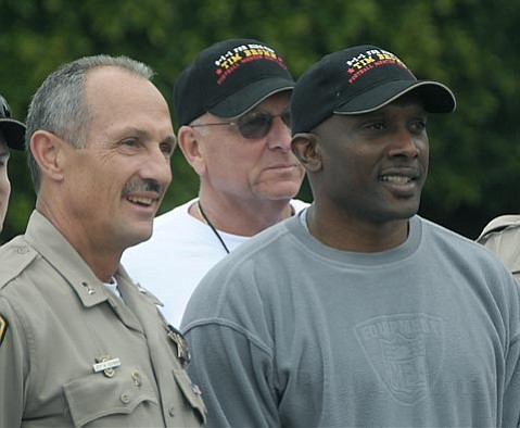 CHP Capt. Jeff Sgobba (left) and Tim Brown get thier photo taken on the Notre Dame campus in Santa Barbara, CA June 29, 2010