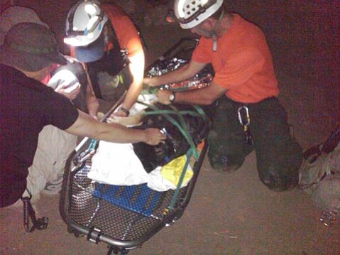 Val strapped to a rescue stretcher