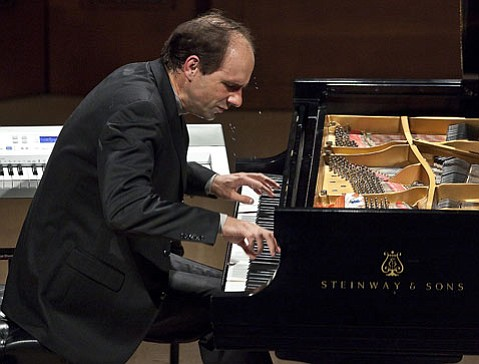 Christopher Taylor performed two challenging works for solo piano on a single program.