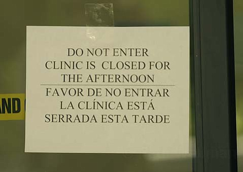 One of many like signs on the door of a closed County Public Health building Aug. 2, 2010