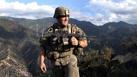 Specialist Kyle Steiner of Second Platoon, Battle Company, 173rd US Airborne at Outpost Restrepo. Korengal Valley, Afghanistan, Kunar Province. 2008.