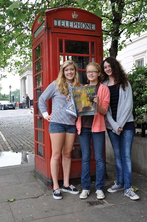 Natalie (left) and Camille (center) Wyss and their friend Emily Clark (right).