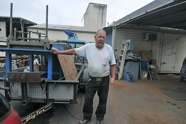 <strong>ROCK AND A HARD PLACE:</strong>  It is game over for the majority of the craftspeople, like welder Ray Duncan (pictured above moving out his stuff late last month), who have been working for decades at Janet Nancarrow's 120 Gray Avenue property. City zoning violations and a property owner unwilling to run the gauntlet needed to remedy them have more than a dozen businesses out on the street and, in many cases, simply out of business. In their place, as per the city's current zoning requirement, will be a parking lot.