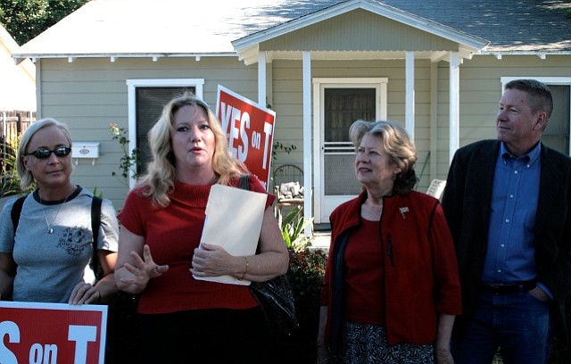 Sharon Byrne, second from left, speaks during the press conference yesterday with councilmembers Michael Self and Dale Francisco looking on.