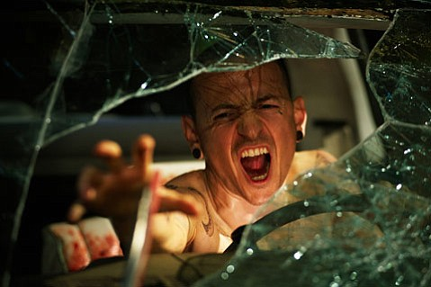 <strong>Just Foolin':</strong>  Stock horror schtick prevails, like those afflicting Chester Bennington, in <em>Saw3D</em>, whose producers seem to have forgotten what to do with the 3D part of the title.