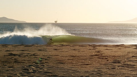 An unknown waveslider mining the stoke on an empty stretch of sand not very far at all from where you sleep.