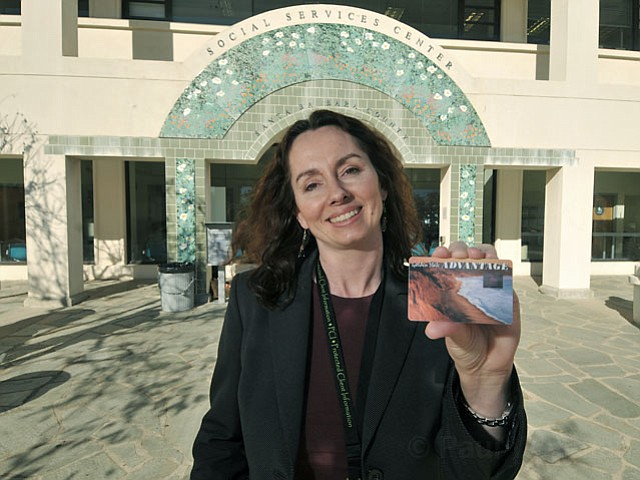 <strong>SO NOT STREAMLINED:</strong>  Maria Gardner, assistant deputy director for social services in S.B., is working on ways to simplify the process of receiving CalFresh benefits, formerly California's Food Stamp program. Gardner — here holding a food stamp card that replaced the old paper vouchers — and others estimate 36,000 people in S.B. County are eligible for food stamp benefits but are not receiving them partially because the process to qualify is so daunting and time-consuming.