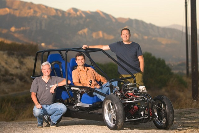Ben Werner (sitting) and Eric Sandoz (standing) of Revolution Motors show off their Dagne prototype