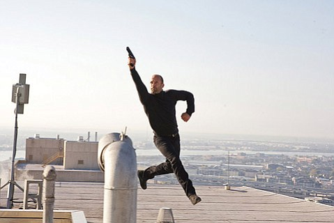 <strong>GUNS UP:</strong>  Jason Statham plays a hit man in <em>The Mechanic</em> who can fall, obviously, with style, and otherwise wreaks mayhem in all the proper bloody-movie ways.