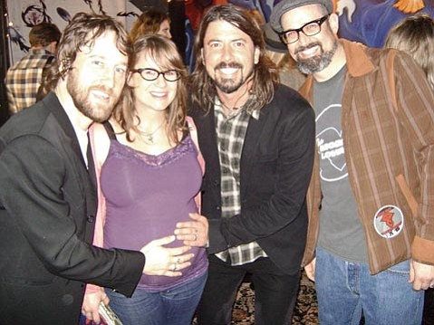 "Nerf Herder's Steve Sherlock (right) once played in a band with Chris Shiflett (left), and was happy to have Dave Grohl (center) bless the unborn baby in his wife's womb after the show on Friday night. Said Steve, ""She will undoubtedly be born into greatness!"""