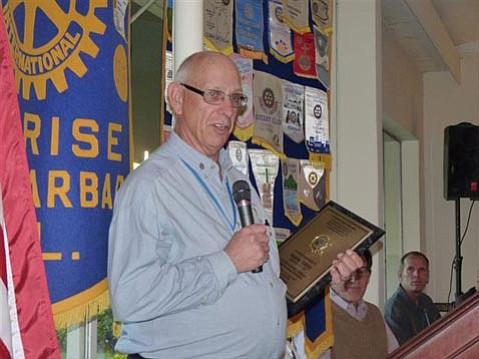 President Bill Boyd with the Boys & Girls Club Award showing the RCSBS membership.