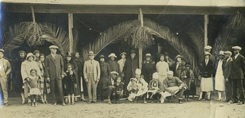 <strong>GROUNDBREAKING NIGHTCLUB:</strong>  In an era where segregation ruled most towns, Otto Hopkins (first man on the left) and his Cotton Club broke down barriers by serving all races. This is a portrait of the club's staff and Hopkins's family members, including his wife, Claire (to Otto's left), and, in her arms, his daughter, Earline Frederick Douglas Hopkins (mother of Wilbur Tate).