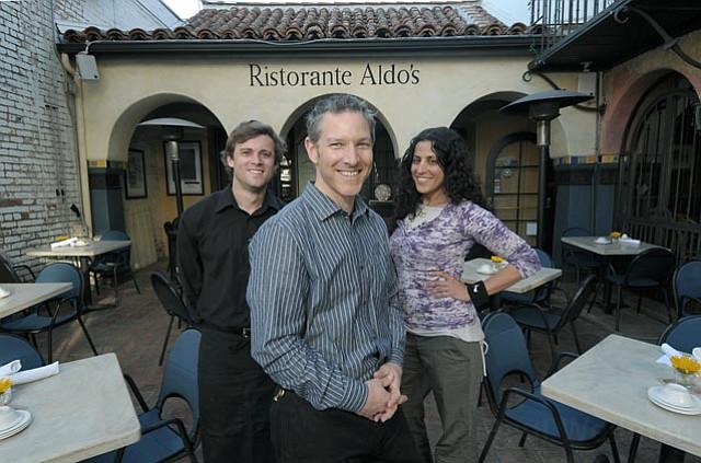 Aldo's new owner Brad Sherman (center) with server Jeremy Del Bianco (right) and marketing manager Karen Gabai (left)