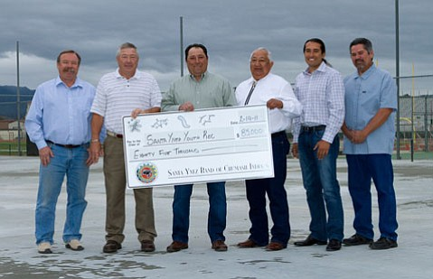 Pictured left to right: Bob Voorhis and Frank Kelsey on behalf of Santa Ynez Valley Youth Rec, Santa Ynez Band of Chumash Indians Chairman Vincent Armenta, Vice-Chairman Richard Gomez and Business Committee members Ken Kahn and Gary Pace.