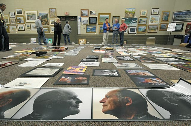 The scene at the downtown library as committee members evaluated hundreds of artworks submitted to the Grandparent Portrait Show, on view at the Faulkner Gallery through March 24.
