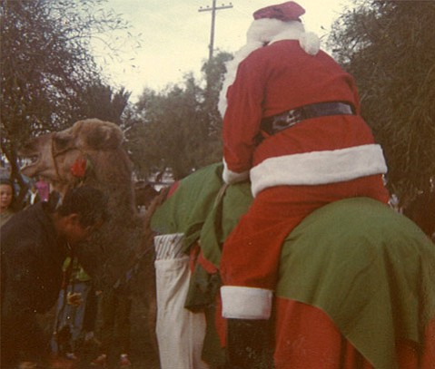 "<strong>CAMEL CHRISTMAS:</strong> Santa Claus greets a crowd on a ""desert reindeer"" at Wheelus Air Force Base in Libya in 1969."