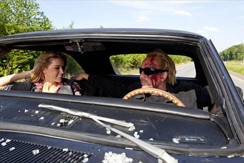 <strong>MR. CAGE'S WILD RIDE:</strong>  Nicholas Cage churns out another bizarre performance, this time as a Hell escapee with revenge on his mind, in the 3-D B-movie <em>Drive Angry</em>.