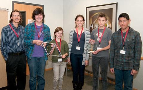 left to right: teacher Rob Goettler, Whittaker Hamill, Sofia Lochner, Caroline Vance, Jay Miley, Alex Rubio.... show off their award.