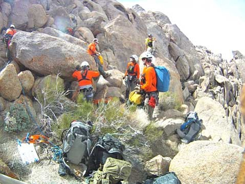 Members of Santa Barbara County SAR setting up anchors for rope systems to raise a simulated injured subject up a rock face during their technical re-accreditation test.