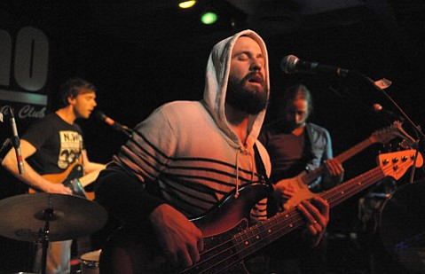 A hooded Miles Seaton led Akron/Family through a lengthy set of folk-tinged, psychedelic-inspired experimental tunes on Thursday night at SOhO.