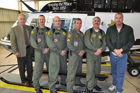 Members of the Santa Barbara Sheriff's Aviation Unit (left to right, Lieutenant Sonny LeGault, pilot retired-Deputy Dave Wight, Detective Adam Reichick, pilot Sergeant Gregg Weitzman, Senior Deputy Jon Simon, mechanic Mel Mobley)