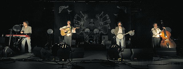 """The band (from left): Ben Lovett, Mumford, """"Country"""" Winston Marshall, and Ted Dwane."""