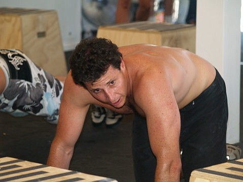 Eric Malzone gets sweaty during the grand opening of CrossFit Pacific Coast two years ago.