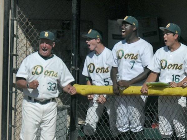 SBHS coach Fred Warrecker cheers Danny Zandona's home run.