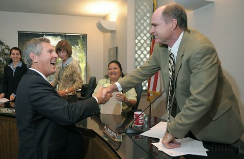 Incoming Santa Barbara Unified School District Superintendent Dr. David Cash (left) shakes the hand of outgoing Superintendent Dr. Brian Sarvis