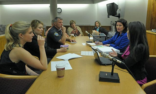 At a pre-court meeting, representatives from the law enforcement, legal, public defense, and mental health fields brainstormed ways to get chronic minor offenders, usually homeless, to change their lifestyles.  from right:  Deputy Public Defender Jennifer Archer, Commissioner Pauline Maxwell, Jail Discharge Planner Tona Wakefield, mental health expert Norma Benavides, Restorative Policing Officer Keld Hove, attorney Emily Allen, and intern Lauren Volkmann.