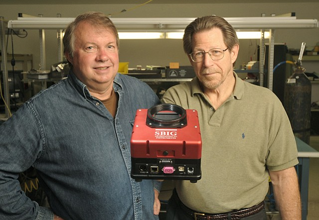 SBIG owners Alan Holmes (left) and Mike Barber holding the latest camera model, STX-16803.