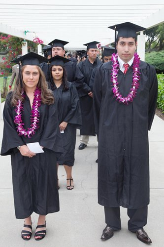 Keynote speakers Amanda Elliott and Bryan Martinez prepare to lead the procession of graduating students at the ninth annual Adult High School/GED graduation on June 10 sponsored by the SBCC Continuing Education Division.